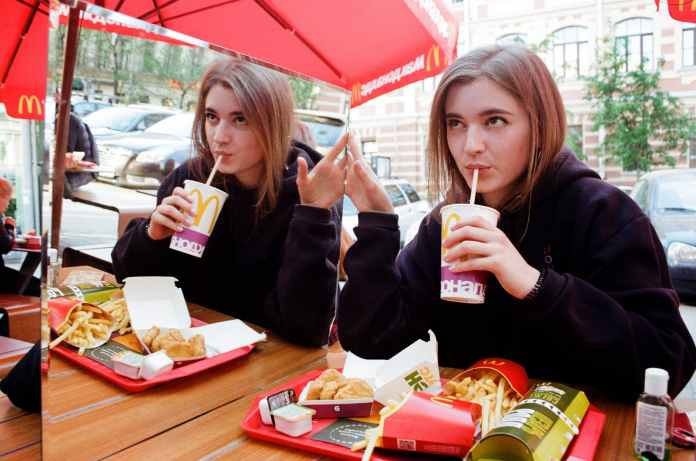 photo of a woman eating on mcdonald s